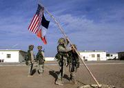 U.S. Marines raise two flags on the Marine forward base in southern Afghanistan. The flag below the American flag Friday is the flag of New York City.