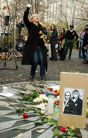 Shelley Joy says a prayer for peace and in memory of former Beatle George Harrison at Strawberry Fields in New York's Central Park.