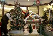 For creative holiday decorating ideas, look no further than the Lawrence Memorial Hospital Gift Shop. Carol Aust, manager, left, and volunteer Bea Carlson have created beautiful scenes in several themes, including this gingerbread tree and house.
