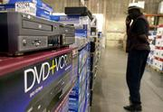 Some machines combine the old and the new, like this DVD and VCR combination player on the shelf at a Costco Warehouse store in Mountain View, Calif.