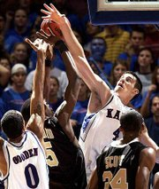 Kansas University's Nick Collison (4) skies to block a shot by Wake Forest's Josh Howard in the second half. Collison finished with 16 points and 11 boards in the Jayhawks' 83-76 victory over the Demon Deacons on Tuesday at Allen Fieldhouse.