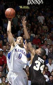 Kansas' Drew Gooden (0) launches a hook shot over Wake's Antwan Scott. Gooden had 11 points in KU's 83-76 victory over the Demon Deacons on Tuesday at Allen Fieldhouse.