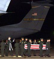 The coffin of an American soldier, who was killed by an errant U.S. bomb in Afghanistan, arrives at the Ramstein Airbase in Germany. The bodies of three American military personnel arrived late Thursday from Afghanistan.