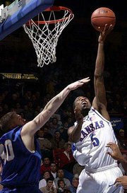 KU's Keith Langford (5) launches a shot over UMKC's Will Palmer.