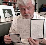 Robert Hirst holds a letter handwritten by author Mark Twain. The letter, written in the 1890s, is one of eight Twain letters recently acquired by the University of California in Berkeley. Hirst heads the school's Mark Twain Project, a growing collection of home of some 3,000 letters by Twain.