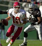 Kansas City's Trent Green (10) scrambles away from Oakland's William Thomas. The Raiders won Sunday at Oakland, Calif.
