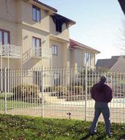KU professor Saeed Farokhi surveys the fire damage to his home.