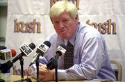 George O'Leary speaks to the media during a news conference Thursday at South Bend, Ind. Notre Dame announced Friday that O'Leary had resigned as football coach after admitting he had lied about his background.