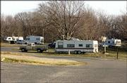 The Clinton Lake State Park campground has occupants year-round. Although Christmas decorations are few, residents of the little neighborhood say they are lacking for little.