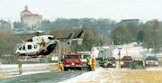 Icy road conditions contributed to an injury accident on East 1400 Road in January 2001. A Lawrence woman was flown from the scene by LifeStar, and her two children were injured in the one-vehicle accident. Some worry that the emergency helicopter flights, which cost about $6,000, are used too often.