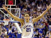 Tayshaun Prince celebrates during the closing moments of Kentucky's 82-62 victory over in-state rival Louisville. Prince had 18 points and nine rebounds Saturday at Lexington, Ky.