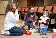 Sara Everly, 11, and Emily Miller, 12, practice their baby-sitting skills with Kahlee Crossno, 3, during a recent Safe Sitter class at Lawrence Memorial Hospital. During the daylong course, students learn how to care for children and handle home emergencies.