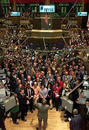 "New York Stock Exchange employees close a down year on Wall Street by singing ""God Bless America"" on the trading floor. Analysts are hoping that Monday&squot;s upbeat singing is a sign of upbeat trading for 2002."