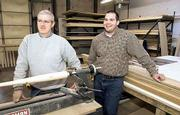 Calvin Ledbetter, left, and Sparky Wilhelm have a growing business with Diamond Cabinetry & Wood Products Inc., 641 E. 22nd. In addition to custom cabinets, they also make wood baseball bats.