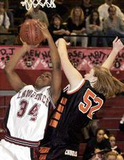 Lawrence's Cherrale Ricks shoots over Mandy Smith of Shawnee Mission Northwest.