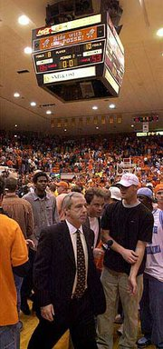 Kansas University Coach Roy Williams walks off the court following the Jayhawks' 86-53 loss to Oklahoma State two years ago in Stillwater, Okla. It was the third-worst loss in KU history. The No. 4 Jayhawks will play the No. 6 Cowboys tonight in Stillwater.