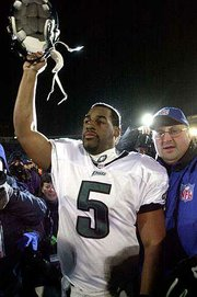Philadelphia quarterback Donovan McNabb celebrates as he leaves Soldier Field. The Eagles defeated Chicago, 33-19, in a NFC Divisional playoff game Saturday in Chicago.