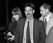 Marilyn Walker, left, and Frank Lindh, right, the estranged parents of American Taliban fighter John Walker Lindh, arrive at the Alexandria Detention Center in Alexandria, Va., escorted by attorney George Harris, center, one of four lawyers for the younger Lindh. Walker and the elder Lindh were not allowed to see their son.