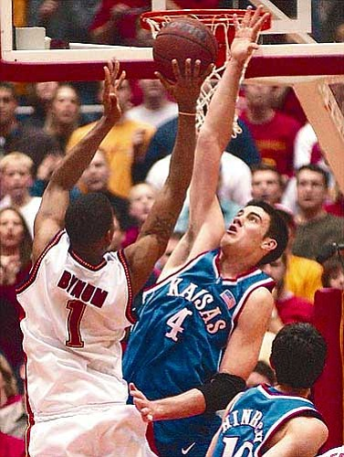 Ku's Nick Collison (4) skies to block a shot by Iowa State's Omar Bynum.