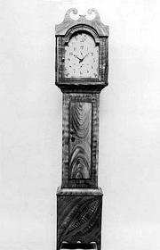 "This grandfather clock is labeled ""R. Whiting, Winchester Wood Works."" The case is grain-painted pine. Riley Whiting worked in Connecticut from about 1813 to 1835. The clock auctioned for almost $8,000 at Cyr Auction Co. in Gray, Maine."
