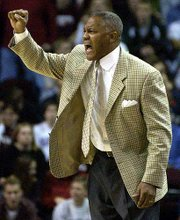 Texas A&M coach Melvin Watkins calls a play in the second half.