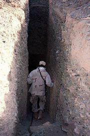 Steve, a Marine master sergeant from Kansas, enters a tunnel in a valley outside Kandahar, Afghanistan, in this photo from earlier this month. With the Taliban ousted from power, the battle has shifted to the painstaking search of caves and other remote locations for al-Qaida and Taliban renegades and intelligence to prevent further terrorist attacks.