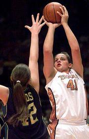 Stacy Stephens of Texas shoots over Baylor's Kelly Sords. Baylor won Saturday at Austin, Texas.