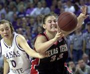 Texas Tech's Jolee Ayers (33) struggles to pass as she is fouled by Kansas State's Laurie Koehn. K-State won, 76-63, on Sunday in Manhattan.