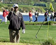 Actor Samuel L. Jackson tosses his wedge after failing to hit the ball out of a sand bunker. Jackson was competing in the AT&T Pebble Beach National Pro-Am on Wednesday at Pebble Beach Golf Links in Pebble Beach, Calif.