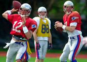 New England quarterbacks Tom Brady, left, and Drew Bledsoe, right, prepare for Sunday's Super Bowl against St. Louis. Patriots coach Bill Belichick said after practice Wednesday in New Orleans that Brady would start against the Rams.