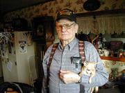 Al Duckworth, 72, who lives in rural Jefferson County, stands with Tugger, one of his three chihuahuas. Duckworth recently received a Korean War Service Medal from Kim Dae-jung, president of South Korea, commemorating his service in the Korean War. Duckworth is one of 115,000 veterans who have received the medals as tokens of appreciation from the Korean government. All 1.8 million American service men and women who served in Korea are eligible.