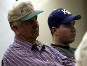 Douglas County FARMERS Richard Eckman, left, and A.J. Thompson attend the bankrupt Farmers Cooperative Assn. meeting at the Douglas County 4-H Fairgrounds. They learned Thursday that the cooperative plans to pay unpaid farmers and businesses by the end of March.