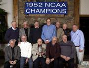 Members of KU's 1952 basketball team returned to Lawrence this weekend to celebrate the 50th anniversary of their NCAA national championship. They are, from left, (front row) Dean Smith, Bob Kenney, manager Wayne Louderback, Bill Lienhard, B.H. Born, (back row) Bill Heitholt, Everett Dye, Jerry Alberts, Clyde Lovellette, Bill Hougland, Charlie Hoag and Allen Kelley. The team gathered at Hougland's home Friday in Lawrence and will be honored at halftime of today's game against Colorado at Allen Fieldhouse.