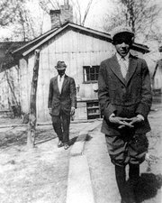 Langston Hughes, foreground, stands outside his boyhood home in Lawrence in this circa 1914 photo. Hughes left Lawrence a year later to live with his mother in Lincoln, Ill. He eventually moved to New York, where he became the literary stalwart of the 1920s Harlem Renaissance cultural movement. The man in the background is unidentified.