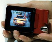 Smaller, compact devices are gaining popularity because of their convenience. Panasonic's new video camera fits into the palm of a user's hand.