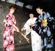 Marguerite Schumm, left, Satoko Morino, center, and Val Wiesner wear traditional yukatas while lighting fireworks a favorite Japanese activity at the Morino home in Hiratsuka.