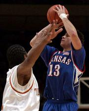 Jeff Boschee fires off a three. Boschee hit six three-pointers, including two in overtime, in the Jayhawks' 110-103 overtime victory over Texas.