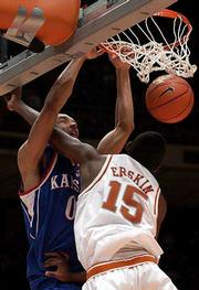 Kansas' Drew Gooden, left, dunks on Texas' Deginald Erskin. Gooden had 28 points in the Jayhawks' 110-103 overtime victory over the Longhorns on Monday in Austin, Texas.