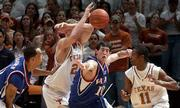 Kansas' Kirk Hinrich (10) breaks up a pass from Texas' Jason Klotz, second from left, intended for T.J. Ford (11). Kansas beat the Longhorns, 110-103 in overtime, on Monday in Austin, Texas.