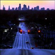 Downtown Kansas City, Mo., is seen in the distance recently as the sun sets. Kansas City Mayor Kay Barnes is proposing $1.8 billion in spending on various projects to revitalize the downtown area.