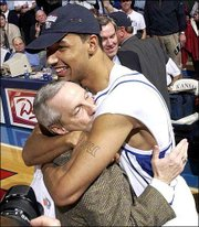 KU's Drew GOoden, right, and coach Roy Williams share a hug.