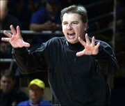Iowa State coach Larry Eustachy yells as his players in the second half.