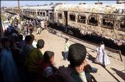 Onlookers watch recovery efforts from a burned train at Reqa al-Gharbiya, Egypt, 60 miles south of Cairo. At least 370 people were reported to have died Wednesday in a blaze that spread through the crowded passenger train.