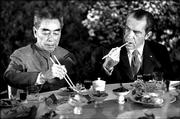 Chinese Premier Chou En-lai, left, and U.S. President Richard Nixon and eat a banquet in Shanghai in this Feb. 28, 1972, file photo. President Bush arrived today 30 years to the day after Nixon's historic visit.