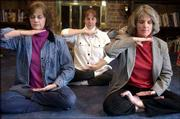 Shown in a meditation position, from left, are Joyce Mitchell, Baldwin, and Rachel Spencer and Cat Rooney, both of Lawrence, in Spencer's home. They were pictured in 2002.