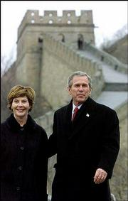 President Bush and first lady Laura Bush take a tour of the Great Wall of China in Badaling. The Great Wall was the Bushes' last stop Friday on their weeklong tour of Asia.