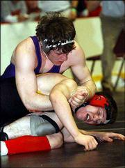 Baldwin's Kyle Flory wrestles Atchison's Jake Welshear in the Class 4A state quarterfinals. Flory won, 18-3, Friday at Wichita and will wrestle for the 171-pound state title today.