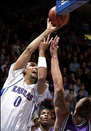 Ku's Drew Gooden, left, bends around KSU's Matt Siebrandt.