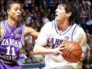 KU's Kirk Hinrich, right, gets past K-State's Larry Reid. Hinrich had a game-high 24 points in the Jayhawks' 103-68 rout on Wednesday at Allen Fieldhouse.