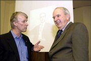 Richard J. Roberts, left, who won a Nobel Prize in 1993 for DNA-related genetic discoveries, talks with Dr. William Jewell, professor of surgery at the KU Medical Center. The two talked Friday at the Walter S. Sutton Symposium at the Med Center, where Roberts spoke.